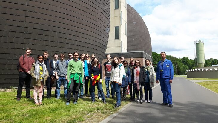 Sudents and lecturers in front of the sewage treatment plant.